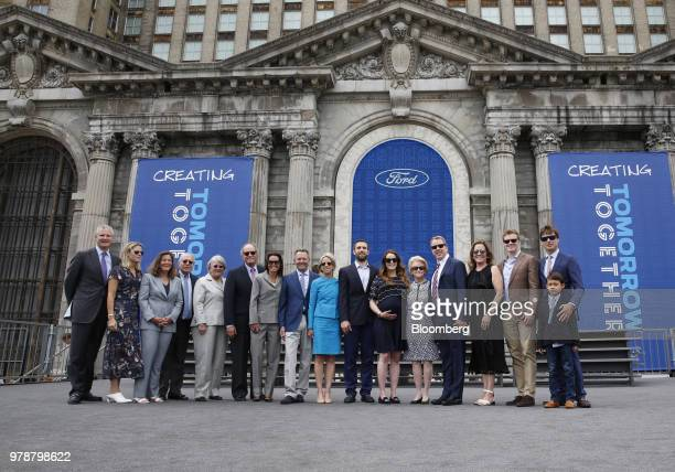 Bill Ford executive chairman of Ford Motor Co fifth right stands for a photograph with his mother Martha Firestone Ford majority owner of the Detroit...