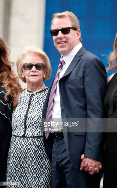 Bill Ford Ford Motor Company Executive Chairman stands next to his mother Martha and the rest of the Ford family in front of the historic 105year old...