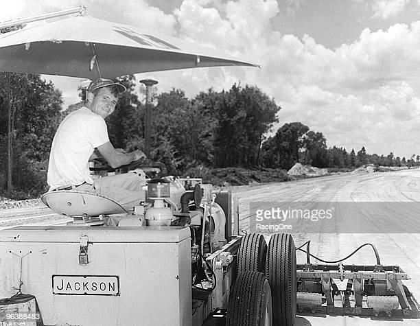 Bill France Jr was very much involved with Daytona International Speedway right from the beginning shown here helping prepare the surface for paving