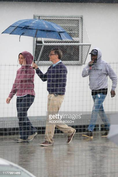 Bill Gates an American philanthropist walks out of Enkanini Primary School in Khayelitsha after visiting the school on October 25 in Cape Town