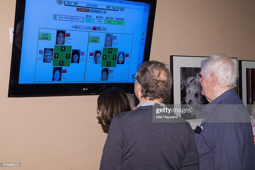 Bill Gates and all-time world top ranked Bridge player Bob Hamman look at a screen showing their tournament spots before they participate in the first live Yeh Online Bridge World Cup at Silver Cloud Hotel on October 31, 2016 in Seattle, Washington.