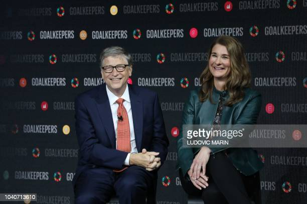 Bill Gates and his wife Melinda Gates speak during the Goalkeepers event at the Lincoln Center on September 26 in New York