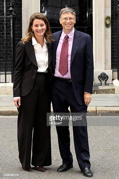 Bill Gates and his wife Melinda pose for photographs outside Number 10 Downing Street on October 18 2010 in London England