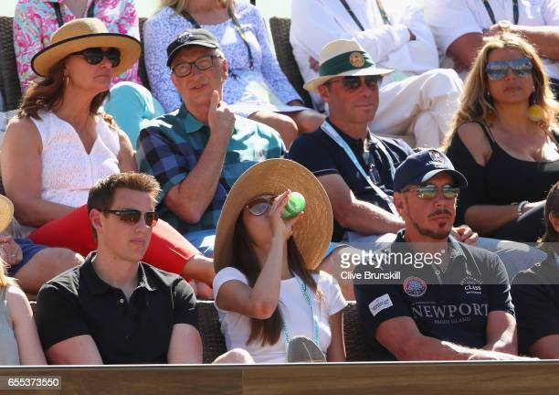 Bill Gates and Larry Ellison watch Roger Federer of Switzerland as he plays against Stanislas Wawrinka of Switzerland in the mens final during day...