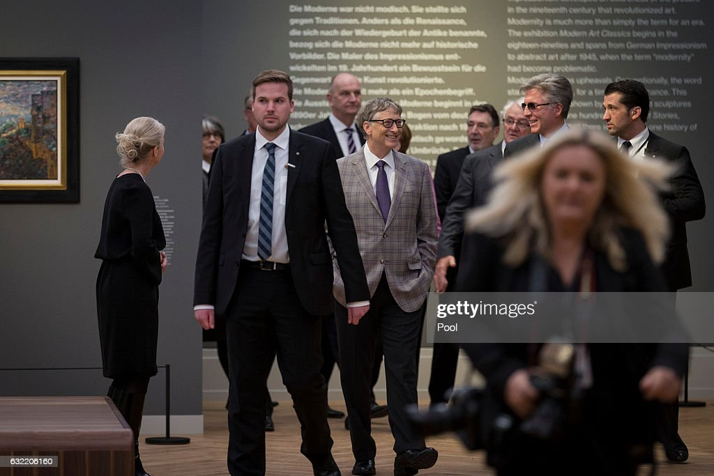 Bill Gates (C) attends the official opening of the Barberini Museum on January 20, 2017 in Potsdam, Germany. The Barberini, patronized by billionaire Hasso Plattner, features works by Monet, Renoir and Caillebotte among others.