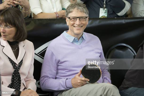 Bill Gates billionaire and cofounder of the Bill and Melinda Gates Foundation smiles while watching attendees play table tennis at an event on the...