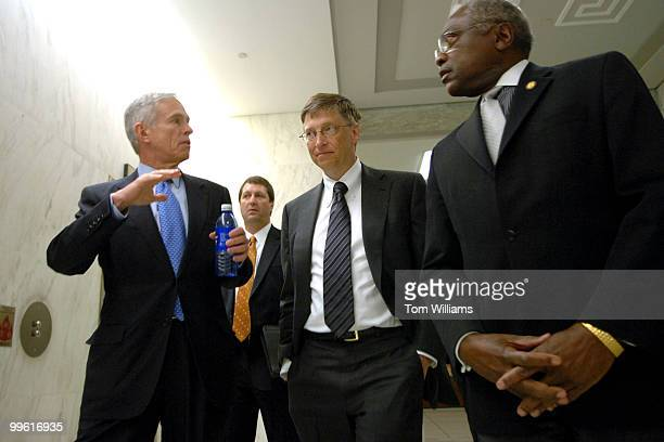 Bill Gates center chairman of Microsoft walks from a House Science Technology Committee hearing with chairman of the Committee Bart Gordon DTenn left...