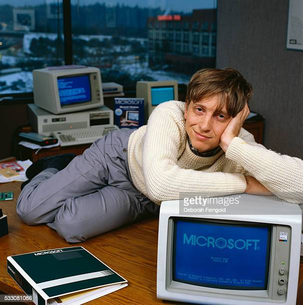 Bill Gates CEO of Microsoft reclines on his desk in his office soon after the release of Windows 10