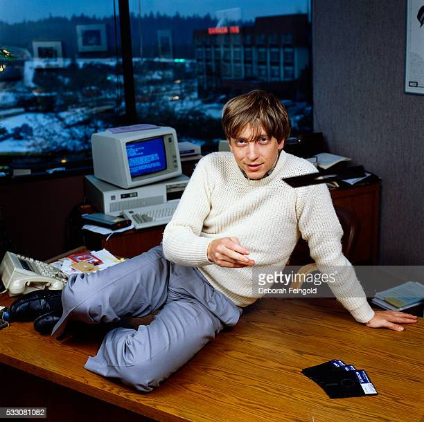 Bill Gates CEO of Microsoft throws a Windows 10 floppy disk in his office soon after the product's release