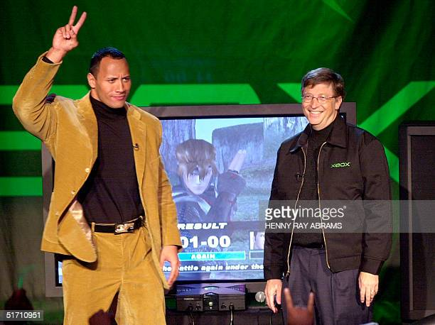 "Bill Gates, chairman and chief software architect of Microsoft, and World Wrestling Federation star Duane ""The Rock"" Johnson greet the crowd at the..."