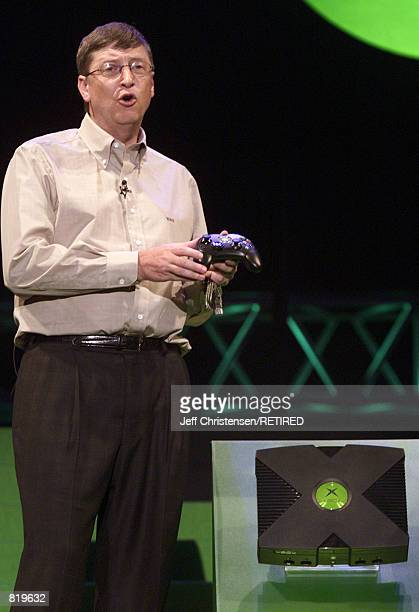 Bill Gates, Chairman and Chief Software Architect of Microsoft, holds the new controller for the new Xbox game during his keynote address at the...