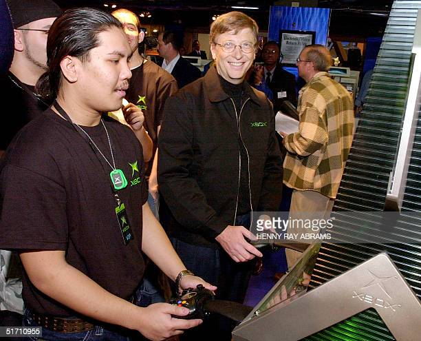 Bill Gates, Chairman and Chief Software Architect of Microsoft plays a game on the new Xbox video game system at a toy store in New York City, 14...