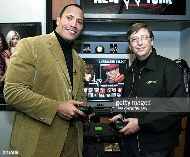 "Bill Gates, chairman and chief software architect of Microsoft, plays an Xbox game with World Wrestling Federation star Duane ""The Rock"" Johnson 14..."