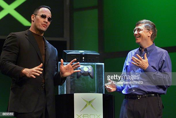 "Bill Gates, Chairman and Chief Software Architect of Microsoft, talks with World Wrestling Federation star ""The Rock"" after Gates unveiled the new..."