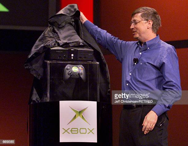 Bill Gates, Chairman and Chief Software Architect of Microsoft, unveils the new Xbox video game console January 6, 2001 during his keynote address at...