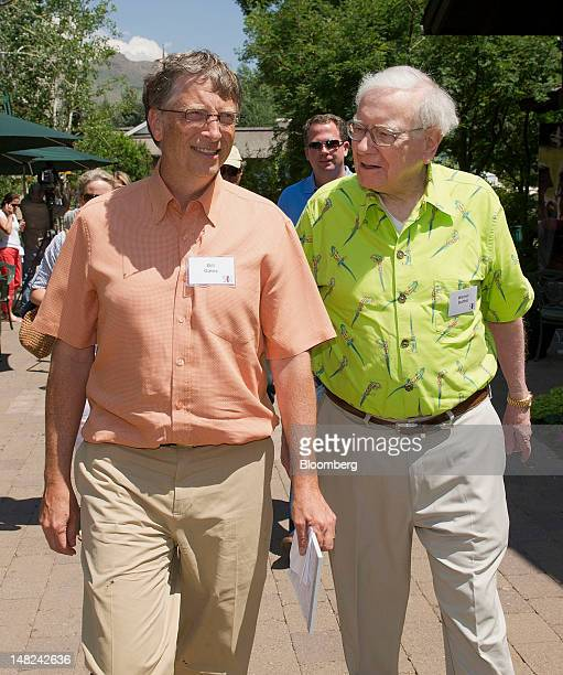 Bill Gates, chairman and founder of Microsoft Corp., left, and Warren Buffett, chairman of Berkshire Hathaway Inc., walk the grounds during the Allen...
