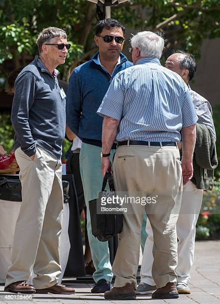 Bill Gates, chairman and founder of Microsoft Corp., left, Nikesh Arora, president of SoftBank Group Corp., center rear, and Masayoshi Son, chairman...