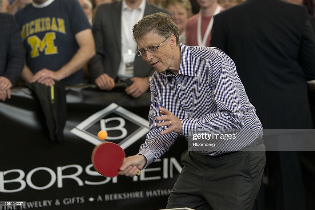 Bill Gates, chairman and founder of Microsoft Corp., returns a ball during a table tennis match with Ariel Hsing, a U.S. table tennis player, outside Borsheims Jewelry Company, Inc., in Omaha, Nebraska, U.S., on Sunday, May 5, 2013. Warren Buffett, the leader of Berkshire Hathaway since the 1960s, said the company's next chief executive officer will bolster the company's reputation as a source of stability in times of crisis. Photographer: Daniel Acker/Bloomberg via Getty Images