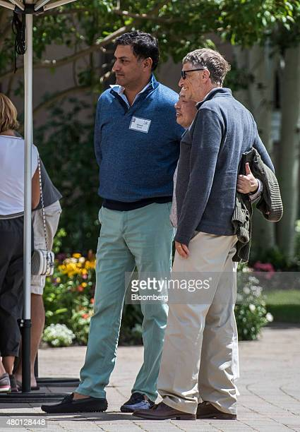 Bill Gates, chairman and founder of Microsoft Corp., right, Masayoshi Son, chairman and chief executive officer of SoftBank Group Corp., center, and...