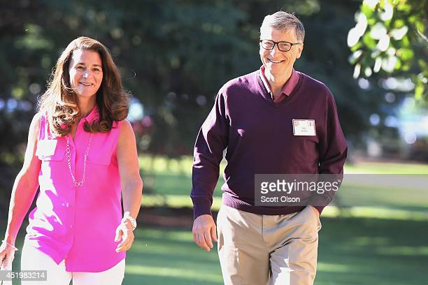 Bill Gates chairman and founder of Microsoft Corp walks with his wife Melinda Gates while attending the Allen Company Sun Valley Conference on July...
