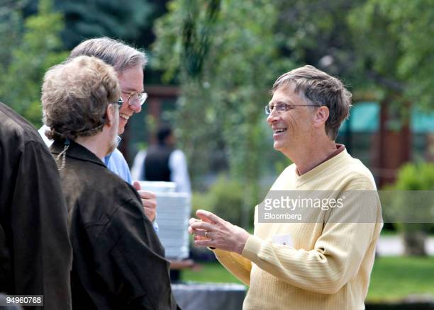Bill Gates chairman of Microsoft Corp right talks with Eric Schmidt chairman and chief executive officer of Google Inc center and Nathan Myhrvold...