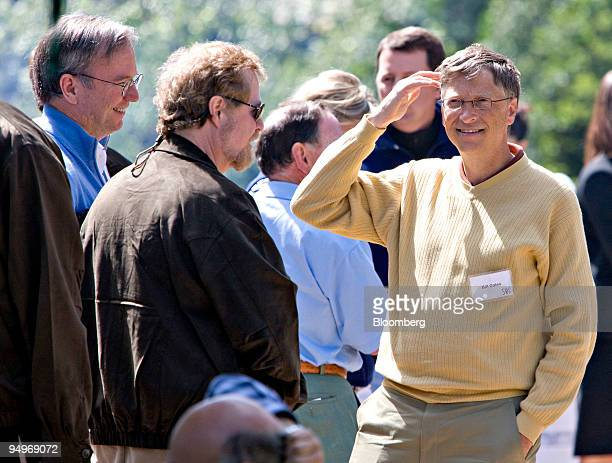 Bill Gates chairman of Microsoft Corp right talks with Eric Schmidt chairman and chief executive officer of Google Inc left and Nathan Myhrvold...