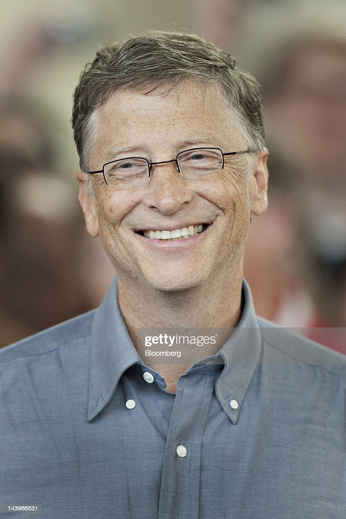 Bill Gates, chairman of Microsoft Corp., smiles after losing a point to Ariel Hsing, a member of the 2012 U.S. Olympic team, as they play table tennis during the Berkshire Hathaway annual shareholders meeting event in Omaha, Nebraska, U.S., on Sunday, May 6, 2012. Berkshire Hathaway Inc. investment managers Todd Combs and Ted Weschler receive $1 million salaries and can earn more if their bets beat the Standard & Poor's 500 Index, Buffett said Sunday. Photographer: Daniel Acker/Bloomberg via Getty Images