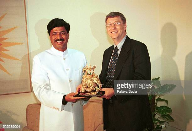 Bill Gates Chairman of Microsoft receives a golden elephant from the Indian Minister of Information Technology Promod Mahajan