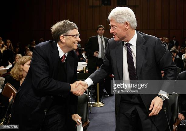 Bill Gates cofounder and cochair of the Bill Melinda Gates Foundation and former US President Bill Clinton shake hands after testifying before the...