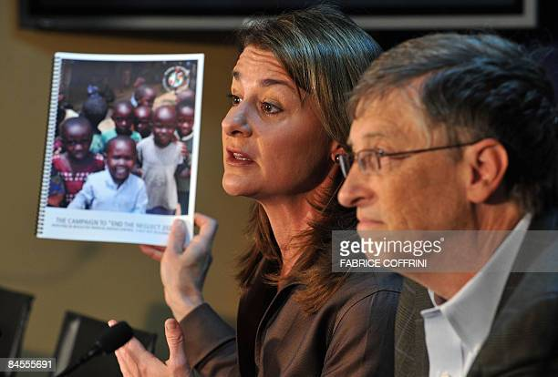 Bill Gates former Microsoft chairman and his wife Melinda are seen during a press conference on their charity foundation on January 30 2009 at the...
