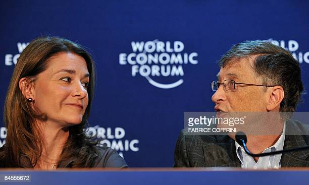 Bill Gates former Microsoft chairman and his wife Melinda speak during a press conference on their charity foundation on January 30 2009 at the World...