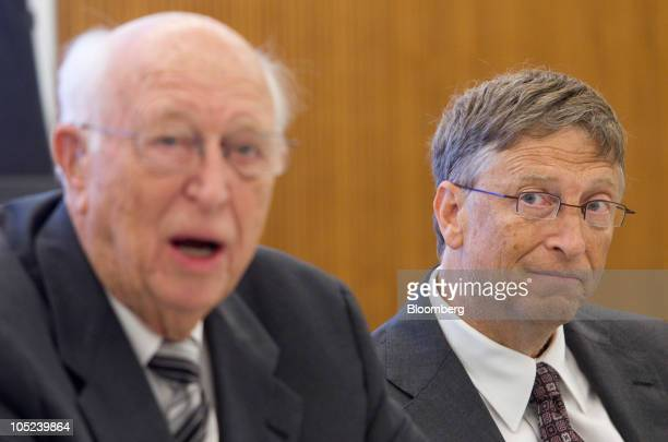 Bill Gates, founder of Microsoft Inc. And co-founder of the Bill and Melinda Gates Foundation, right, looks on as his father Bill Gates Sr. Speaks...
