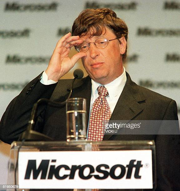 Bill Gates head of US software giant Microsoft shows a distressed outlook at a press conference in Taipei 13 June 2000 when asked to comment on the...