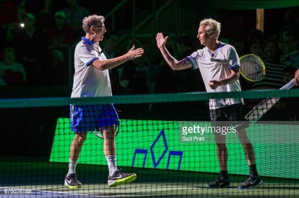 Bill Gates high fives Mike McCready at the Match For Africa 4 exhibition match at KeyArena on April 29, 2017 in Seattle, Washington.
