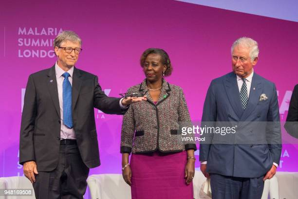 Bill Gates holds a mini drone watched by Prince Charles Prince of Wales and Rwanda's Minister of Foreign Affairs Louise Mushikiwabo during the...