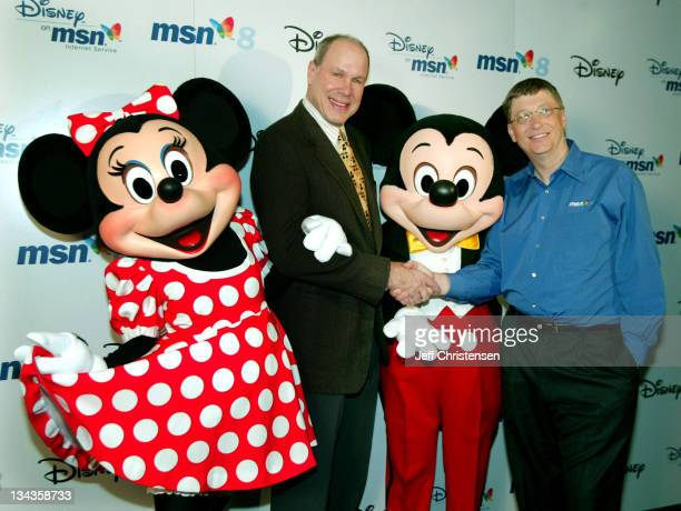 Bill Gates Microsoft chairman and chief software architect and Michael Eisner chairman and CEO of The Walt Disney Company pose with Mickey and Minnie...