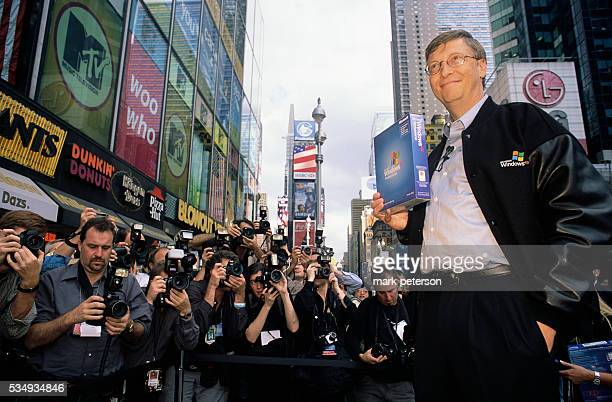 Bill Gates Microsoft's Chairman and Chief Software Architect stands in Times Square holding a Windows XP box This was part of the launch presentation...