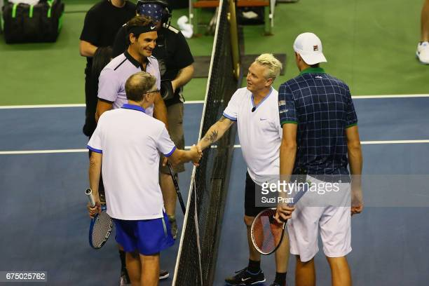 Bill Gates Roger Federer Mike McCready and John Isner greet each other at the Match For Africa 4 exhibition match at KeyArena on April 29 2017 in...