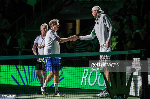 Bill Gates shakes hands with John Isner of the United States at the Match For Africa 4 exhibition match at KeyArena on April 29, 2017 in Seattle,...