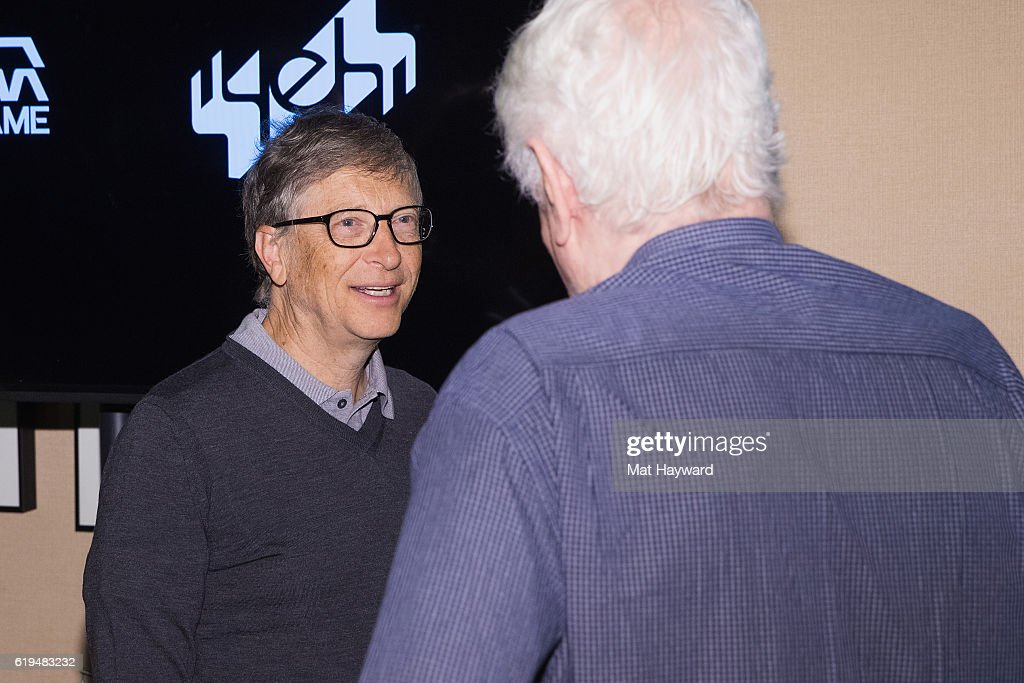 Bill Gates (L) speaks with Bob Hamman, ranked as the world's all-time top Bridge player before the first live Yeh Online Bridge World Cup at Silver Cloud Hotel on October 31, 2016 in Seattle, Washington.