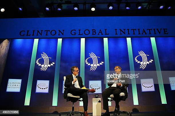 Bill Gates speaks with Michael Gerson on stage at the the annual Clinton Global Initiative meeting on September 27 2015 in New York City The event...
