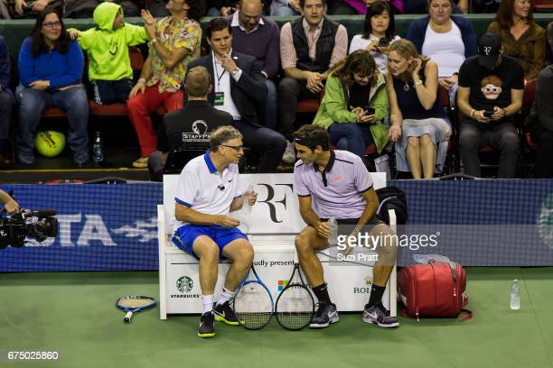 Bill Gates talks with Roger Federer during a break at the Match For Africa 4 exhibition match at KeyArena on April 29, 2017 in Seattle, Washington.