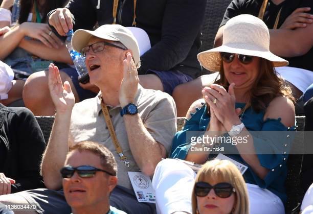 Bill Gates watches Roger Federer of Switzerland play against Hubert Hurkacz of Poland during their men's singles quarter final match on day twelve of...