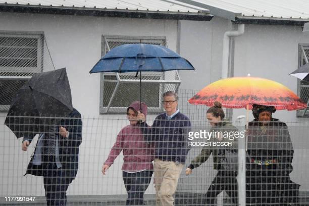 Bill Gatesan American philanthropist walks with his wife Melinda out of Enkanini Primary School in Khayelitsha after visiting the school on October...