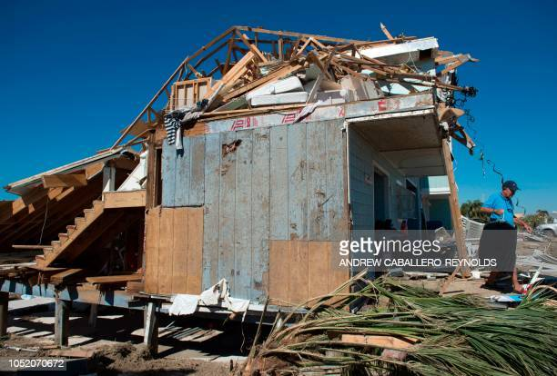 Bill Gerspacher carries clothes out of his destroyed beach house in Port St Joe beach Florida on October 13 three days after hurricane Michael hit...
