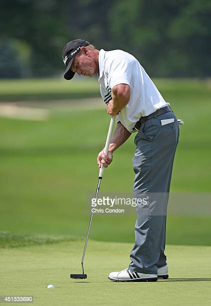 Bill Glasson birdies the 18th hole during the second round of the Constellation SENIOR PLAYERS Championship at Fox Chapel Golf Club on June 27 2014...