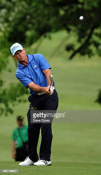Bill Glasson hits his approach shot on the 18th hole during the final round of the Principal Charity Classic at the Wakonda Club on June 1 2014 in...