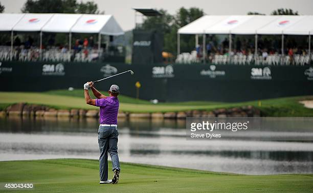 Bill Glasson hits his second shot on the 18th hole during the first round of the 3M Championship at TPC Twin Cities on August 1 2014 in Blaine...