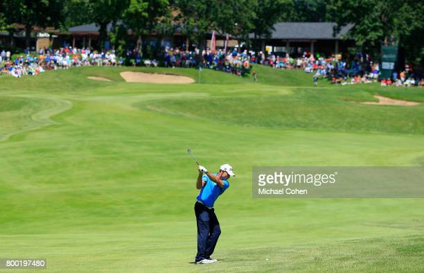 Bill Glasson hits his second shot on the ninth hole during the first round of the American Family Insurance Championship held at University Ridge...