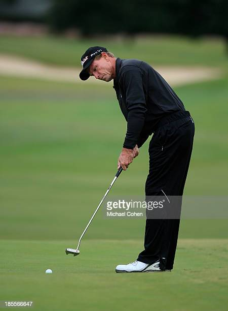 Bill Glasson strokes a birdie putt during the first round of the SAS Championship held at Prestonwood Country Club on October 11 2013 in Cary North...